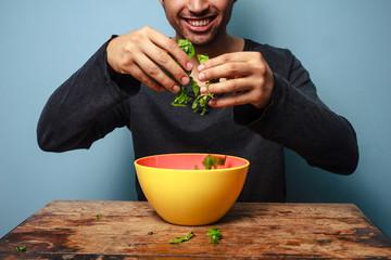 Happy man tossing salad