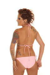 Woman tattoos bikini back look left