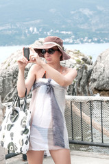 Woman on vacation taking photo