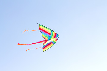 colorful kite flying on background of blue sky