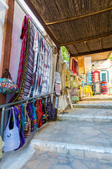 Traditional textiles on a market stall  in Greece