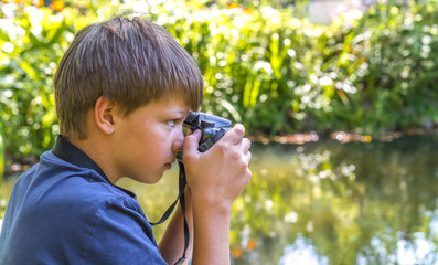 Boy taking photos outdoor