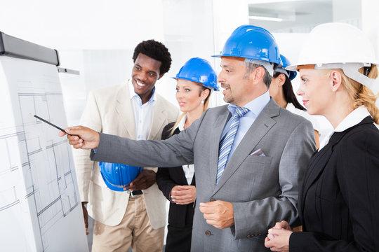Architects Working On Blueprint
