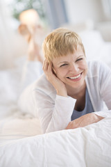 Happy Mature Woman Lying In Bed