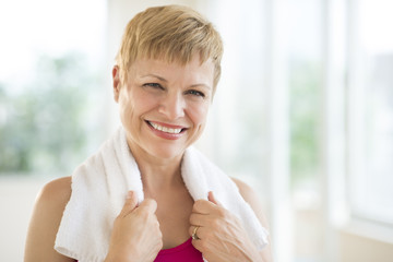 Cheerful Woman With Towel Around Neck
