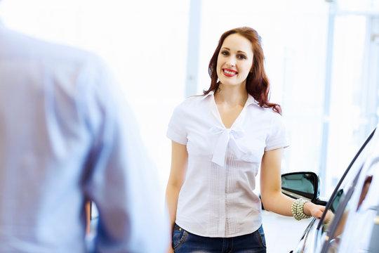 Young woman at car salon