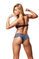 Rear view of pretty and muscular girl with blond hair