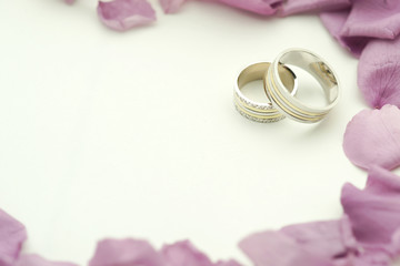 Wedding rings with roses and copy space