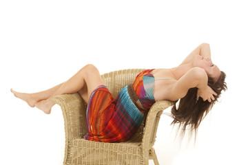 woman sitting colorful dress head back
