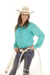 woman western green shirt holding ropes