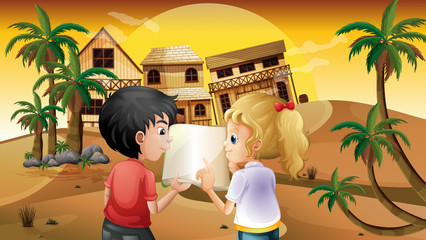 A girl and a boy holding an empty book at the desert