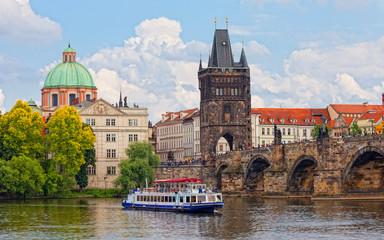 Prague, view of Karlov Bridge and tourists going on it
