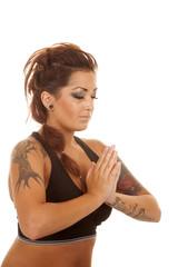 Woman tattoos fitness prayer close