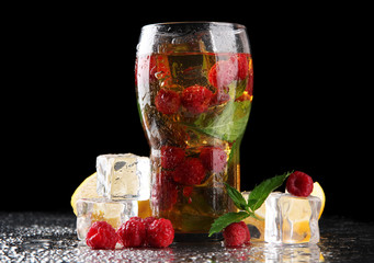 Iced tea with raspberries and mint