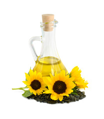 Decorative sunflowers with oil in glass jug