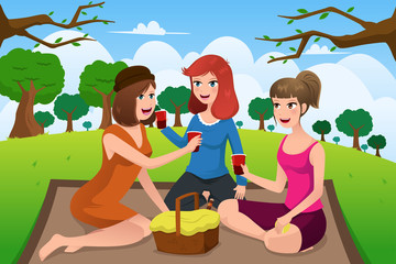Young women having picnic in a park