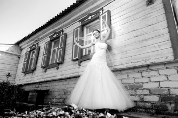 bride near a village house