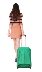 back view of walking  woman  with suitcase