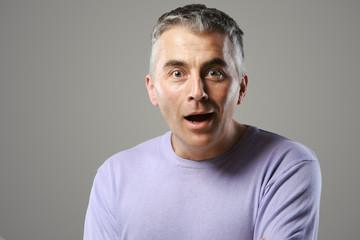 Portrait of casual man surprised