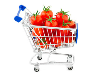 Tomatoes in shopping cart isolated on white