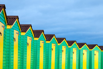Row of Green and Yellow Beach Huts