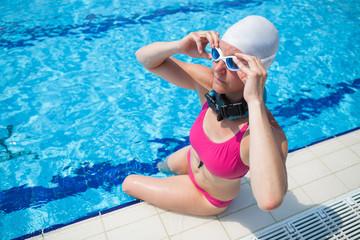 Female swimmer at pool edge