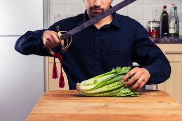 Strange man cutting lettuce with sword
