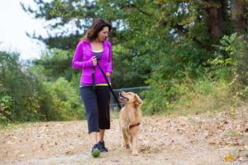 woman walking with dog