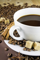 Coffee cup with cinnamon and sugar