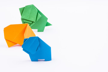 Three origami elephants - white background