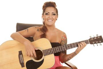 woman tattoos guitar sit smile