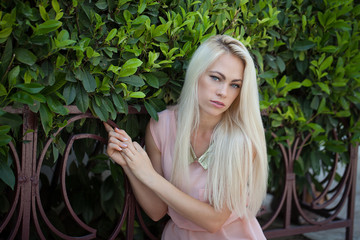 Portrait of beautiful young blond woman outdoors