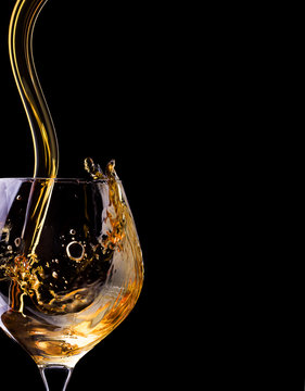 Cognac or brandy on a black