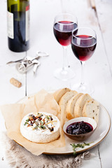 Baked Camembert cheese with red wine and bread