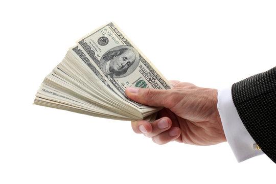 hand holding fan-shaped dollars