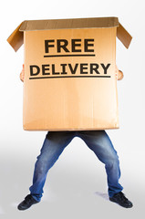 "boy carries a huge package that says ""free delivery"""