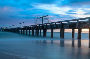 Bridge to the sea with sunset bihind