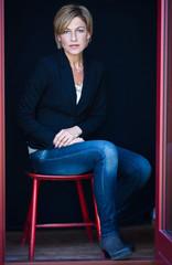 Cute scandinavian woman portrait sitting on a chair
