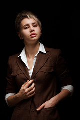 Young woman on a dark background