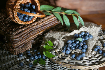 Blueberries in wooden basket and