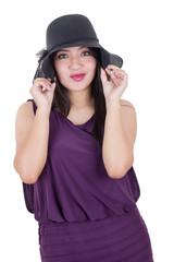 Beautiful hispanic girl wearing a hat smiling isolated on white