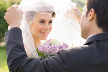 Groom Looking At Bride With Love
