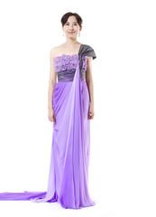 beautiful female fashion model posing in purple dress