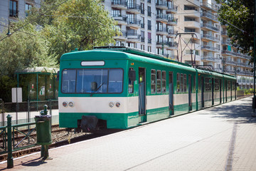 Green suburb train waiting on a staition in Budapest