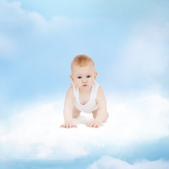 smiling baby sitting on the cloud
