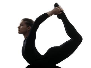 Wall Mural - woman exercising gymnastic yoga urdhva dhanurasana upward bow po