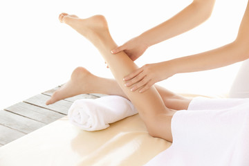 Foot massage . Close-up of a young woman getting spa treatment.