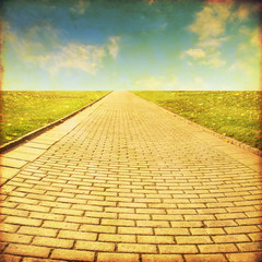 Grunge image of stone pathway in the field.