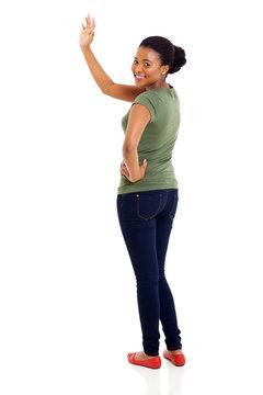 afro american woman waving goodbye