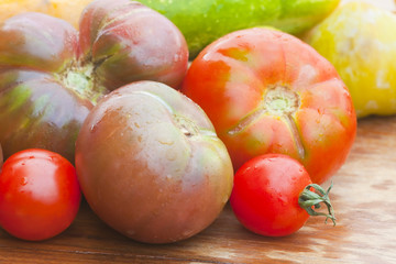 Beef tomatoes on wooden table